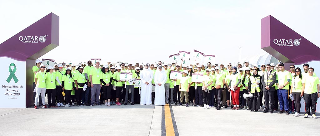 Qatar Airways employees walk 2 [qatarisbooming.com].jpg
